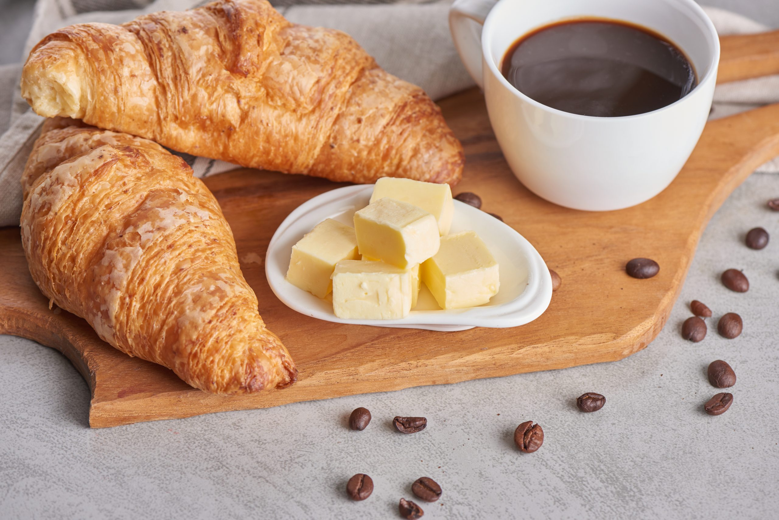 Delicious breakfast with fresh croissants and coffee served with