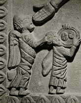 The prophet Habakuk brings bread to Daniel in the lion's pit,as God bade him.Habakuk did not know his way to the city of Babylon where Daniel was imprisoned. Therefore an angel took him by his hair and carried him there. (Daniel 14:33) Limestone relief Inv.2175 T