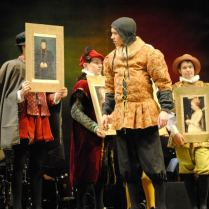 Henry inspects a portrait of Anne of Cleves - Henry VIII The Musical