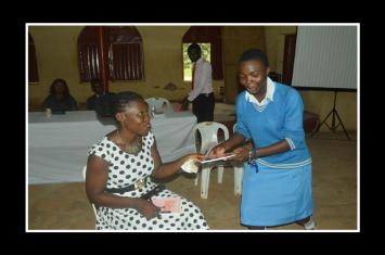 Gifting Chinyere, one of the drame participants her book
