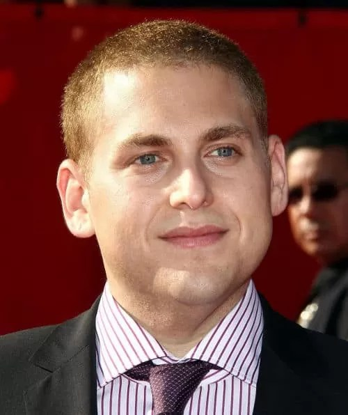 Photo of Jonah Hill short hairstyle.