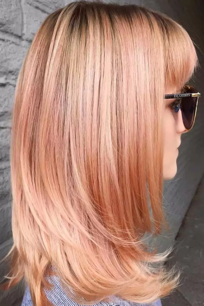 sweet-strawberry-blonde-hair-black-roots-pink
