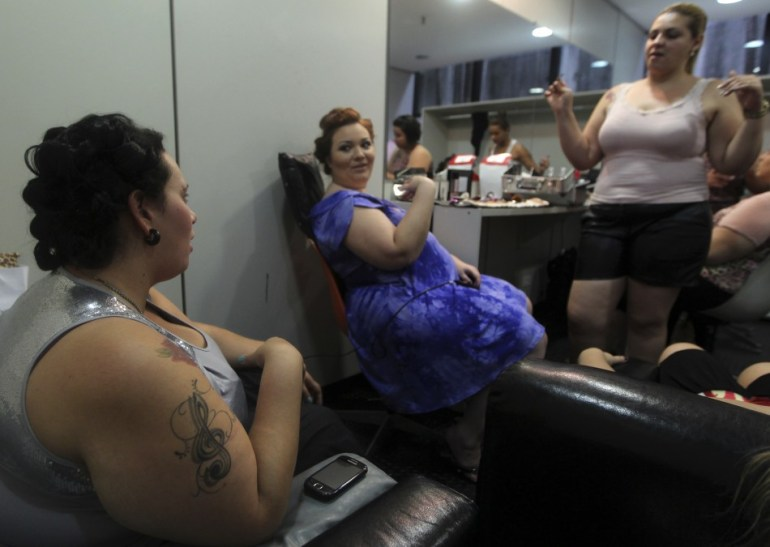 347568-models-prepare-backstage-before-a-presentation-as-part-of-fashion-week