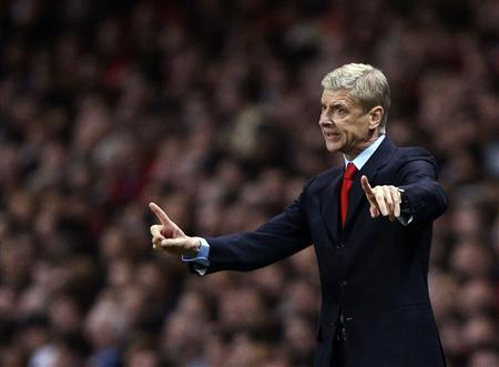 Arsenal's manager Wenger reacts during their Champions League soccer match against Napoli at the Emirates stadium in London
