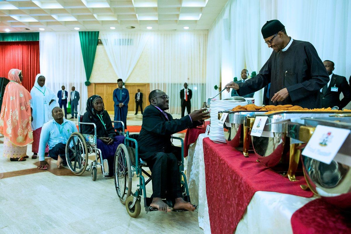 PHOTOS: Buhari acts as Kitchen Server for IDPs and Disabled People ...