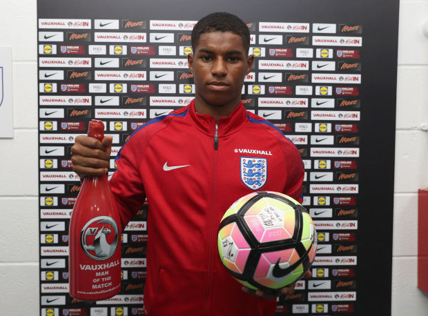 COLCHESTER, ENGLAND - SEPTEMBER 06:  Man of the Match Marcus Rashford of England poses for the camera with his match ball and a bottle of champagne during the UEFA European U21 Championship Qualifier Group 9 between England U21 and Norway U21 at Colchester Community Stadium on September 6, 2016 in Colchester, England.  (Photo by Christopher Lee - The FA/The FA via Getty Images)