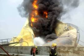 firefighters battle blaze on a tanker at stallionaire oil depot