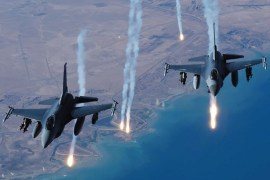 2 fighter jets firing missiles