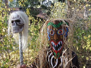 Nigerian witch doctor wearing mask