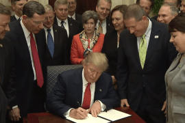 trump signs the HJ resolution 40 bill