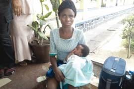 rita nwolu with her baby