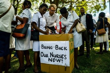 People cast their letters of complaint to Zimbabwe deputy President Chiwenga among nurses who had gathered at Unity Square in Harare on April 20, 2018 to demonstrate their discontent in a #BringBackOurNurses campaign after being summarily dismissed by Zimbabwe Vice President Constantino Chiwenga