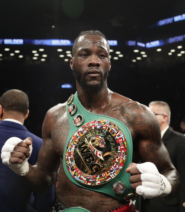 Deontay Wilder poses for photographs after the WBC heavyweight championship bout against Luis Ortiz on Saturday, March 3, 2018, in New York. Wilder won in the 10th round. (AP Photo/Frank Franklin II)