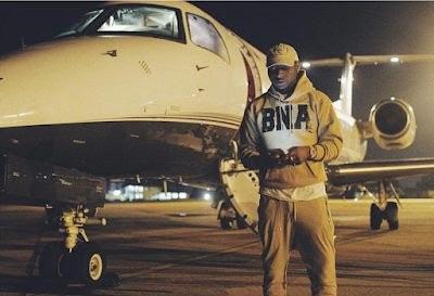 Photo of Davido in front of his dad's Private Jet