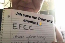 White Woman holds up note defending yahoo boys