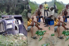 Men drink beer after accident