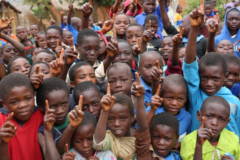 Malawi, April 2014. Children doing the 'First' gesture at the Msesa outreach clinic. Commonwealth Games Glasgow 2014. Put children first.