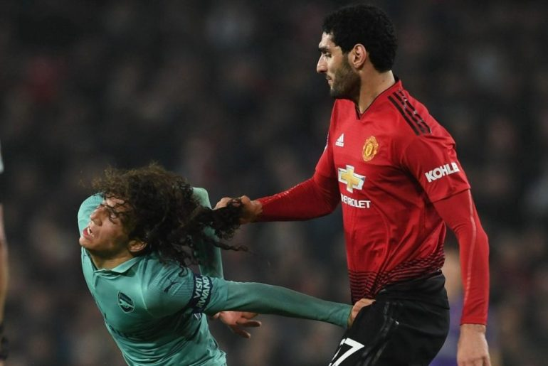 Fellaini pulling Guendouzi's hair