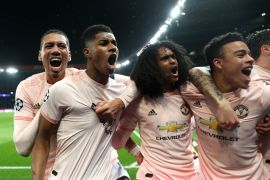 Manchester United players celebrate against PSG