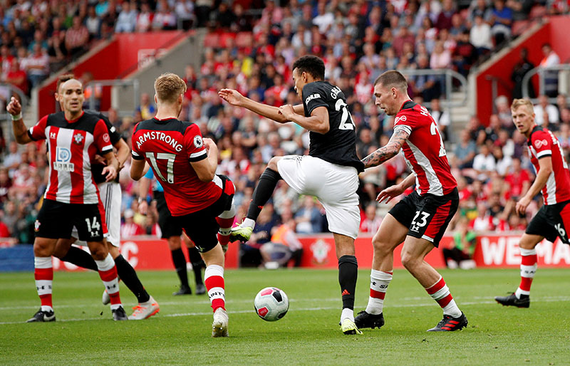 Southampton's Stuart Armstrong and Pierre-Emile Hojbjerg in action with Manchester United's Mason Greenwood during the Premier League match between Southampton and Manchester United, at St Mary's Stadium, in Southampton, Britain, on August 31, 2019. Photo: Action Images via Reuters