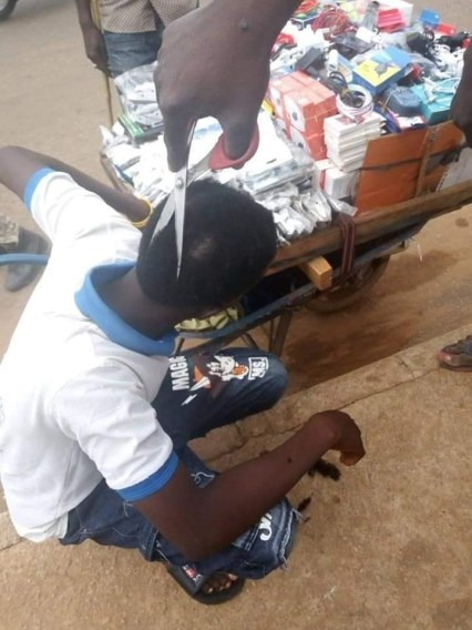 Photos: Police officers cut off young boys' hair using scissors in Niger