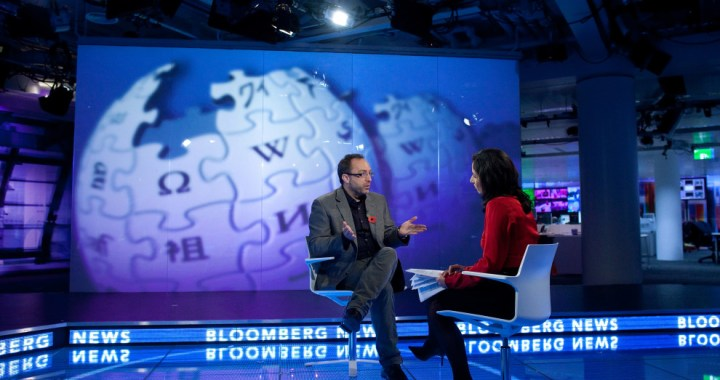 Jimmy Wales, co-founder of Wikipedia, left, gestures during a television interview in London, U.K., on Monday, Nov. 7, 2011. To keep the online encyclopedia free and without advertising, Wikimedia Foundation Inc., the non-profit organization that operates Wikipedia, has held funderaisers since 2005. Photographer: Simon Dawson/Bloomberg via Getty Images