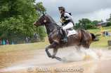 Phil Brown riding HARRY ROBINSON through the 4* water