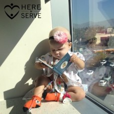 Toddler with pediatric cancer reading a book