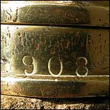 908 - stamped into the base