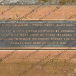 Plaque sited at the base of the monument