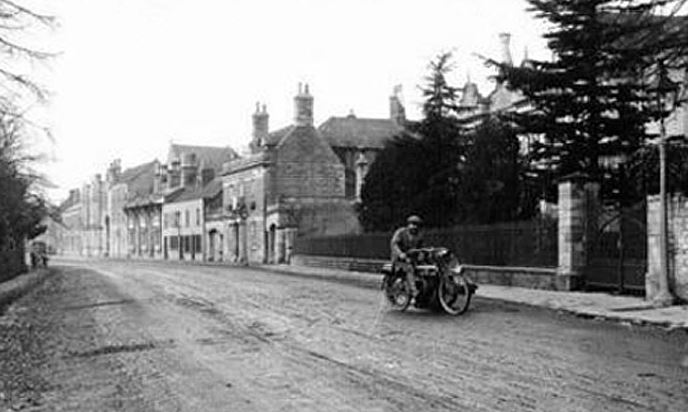 Vintage motorbike heading out from Market Deeping 1930's