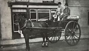 Butcher Tobias W Parsons on his delivery cart 1920's