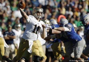 Notre Dame quarterback Tommy Rees (11) passes against Air Force in the first quarter of an NCAA football game in Air Force Academy, Colo., Saturday, Oct. 26, 2013. (AP Photo/David Zalubowski)