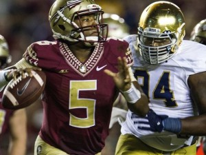 Notre Dame lineman Jarron Jones, right, chases Florida State quarterback Jameis Winson during the second half. (Photo: Mark Wallheiser , Associated Press ).