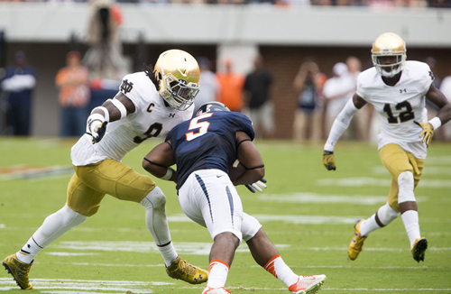 Notre Dame's Jaylon Smith (9) and Devin Butler (12) look to tackle Virginia's Albert Reid (5) during Notre Dame's 34-27 win over Virginia Saturday, September 12, 2015 in Charlottesville. SBT Photo / BECKY MALEWITZ