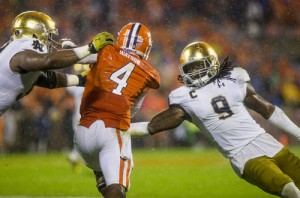Notre Dame's Jerry Tillery (99), left, and Jaylon Smith (9) bring down Clemson's Deshaun Watson(4). SBT Photo/ROBERT FRANKLIN