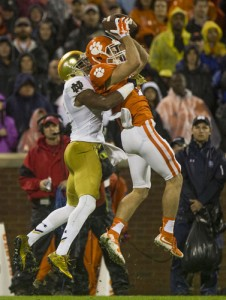 Clemson's Hunter Renfrow (13) makes a catch over Notre Dame's KeiVarae Russell (6). SBT Photo/ROBERT FRANKLIN