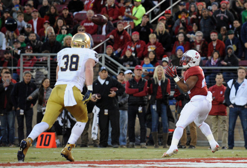 Stanford Cardinal running back Remound Wright (22) catches a touchdown pass against Notre Dame Fighting Irish linebacker Joe Schmidt (38) during the first half at Stanford Stadium.