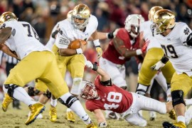 Notre Dame Fighting Irish quarterback DeShone Kizer (14) carries the ball as Stanford Cardinal linebacker Kevin Anderson (48) defends in the fourth quarter at Stanford Stadium. Stanford won 38-36. Matt Cashore/USA TODAY Sports