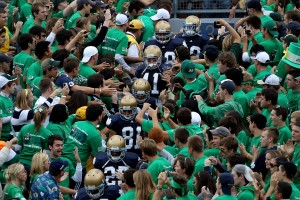 Players from the Notre Dame Fighting Irish walk to the field through the student section for warm-ups before a game against the Purdue Boilermakers at Notre Dame Stadium on September 4, 2010 in South Bend, Indiana. Notre Dame defeated Purdue 23-12. (Photo by Jonathan Daniel/Getty Images)