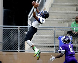 First Coast Buccaneers receiver Kevin Stepherson makes a catch over Gainesville Hurricanes defender RaiJuahn Alexander. (Matt Stamey photo)