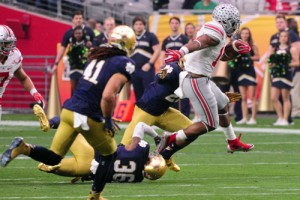 Buckeyes running back Ezekiel Elliott (15) carries the ball as Notre Dame safety Elijah Shumate (22), cornerback Matthias Farley (41) and cornerback Cole Luke (36) defend. Matt Kartozian-USA TODAY Sports