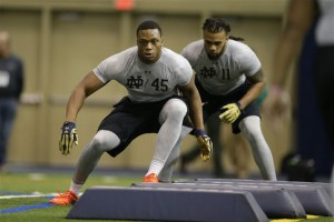 Notre Dame's Romeo Okwara (45) and Ishaq Williams run a drill during Notre Dame's NFL football Pro Day in South Bend, Ind., Thursday, March 31, 2016. (AP Photo/Michael Conroy)