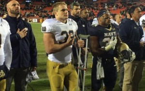 Irish linebacker Joe Schmidt stands with members of the Navy Football team during Navy's Alma Mater. Credit: ND Football Twitter