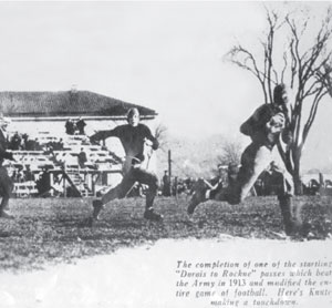 """NYT caption: """"Notre Dame's Knute Rockne, right, scoring on a reception against Army at West Point. Passing was a novelty then, and receivers planted themselves downfield, waiting behind the defense for the roundish ball to arrive."""""""