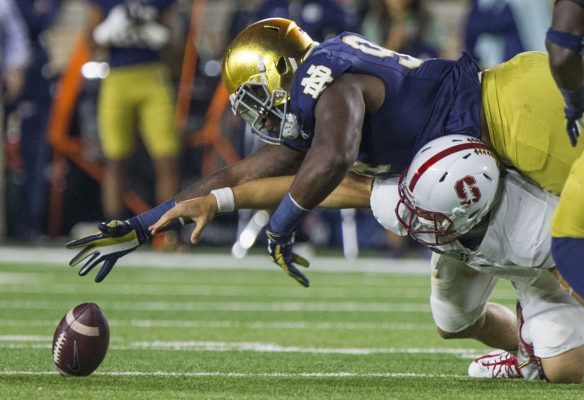 Notre Dame's Jarron Jones (94) goes over Stanford's Ryan Burnes (17) to recover a fumble. (Photo: Robert Franklin, South Bend Tribune)