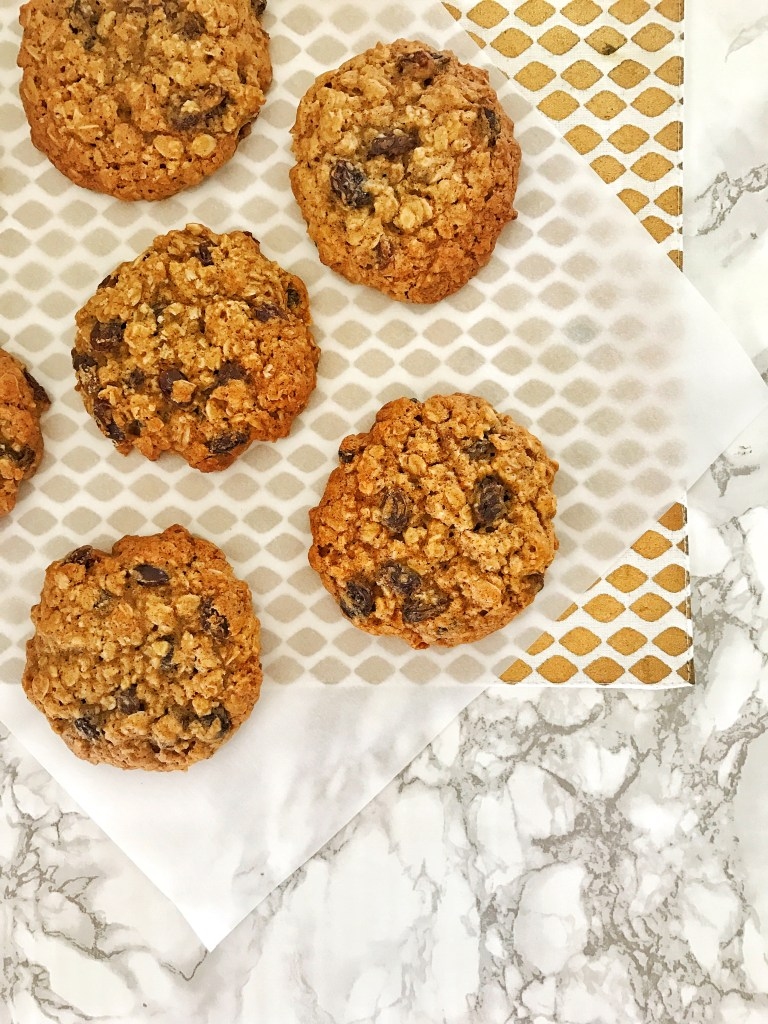 Best Ever Oatmeal Raisin Cookies on parchment