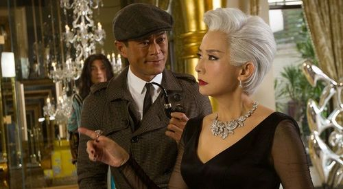Louis Koo, plus deerstalker, with Teresa Mo in An Inspector Calls