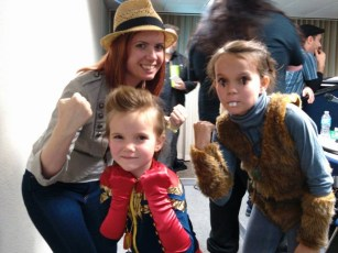 Captain Marvel and Squirrel Girl pose with comic book writer Mindy Owens