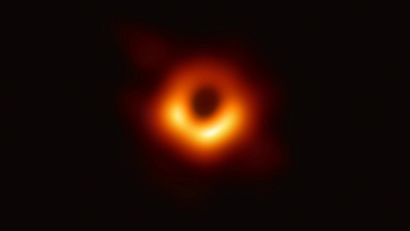 The first photo ever taken of a black hole.
